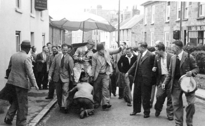 Cyril Bailey being carried in a chair on tour